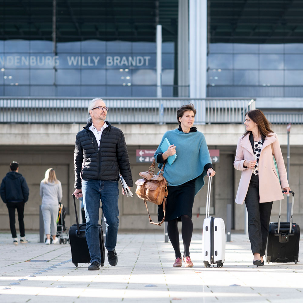 Business travellers at BER Airport