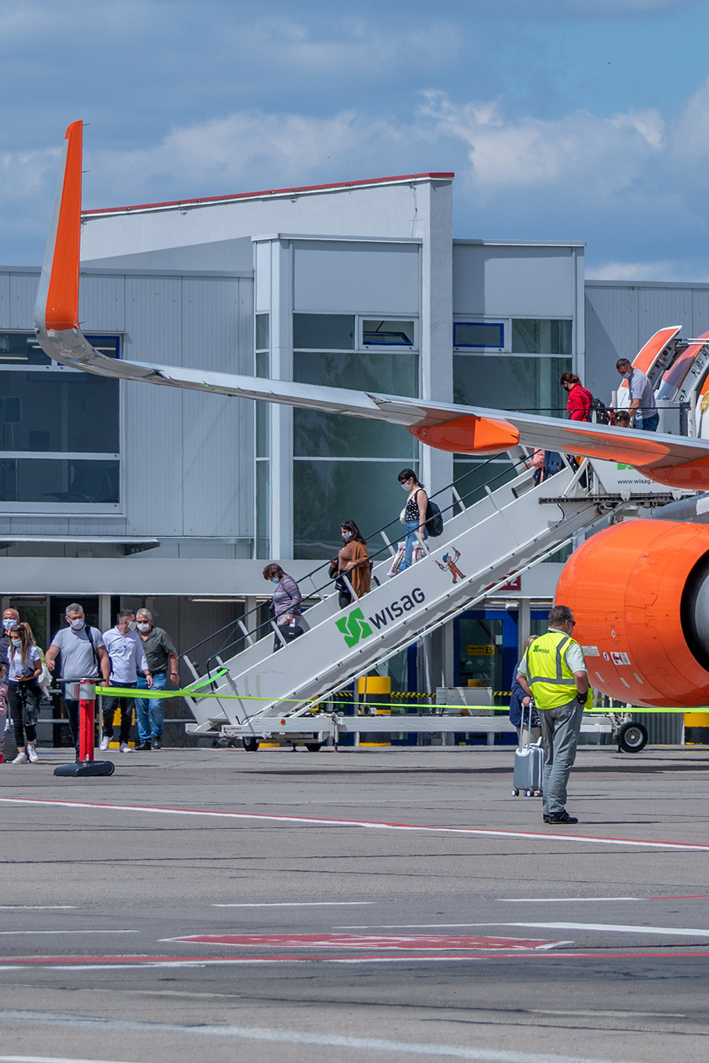 Passengers disembarking from the aircraft