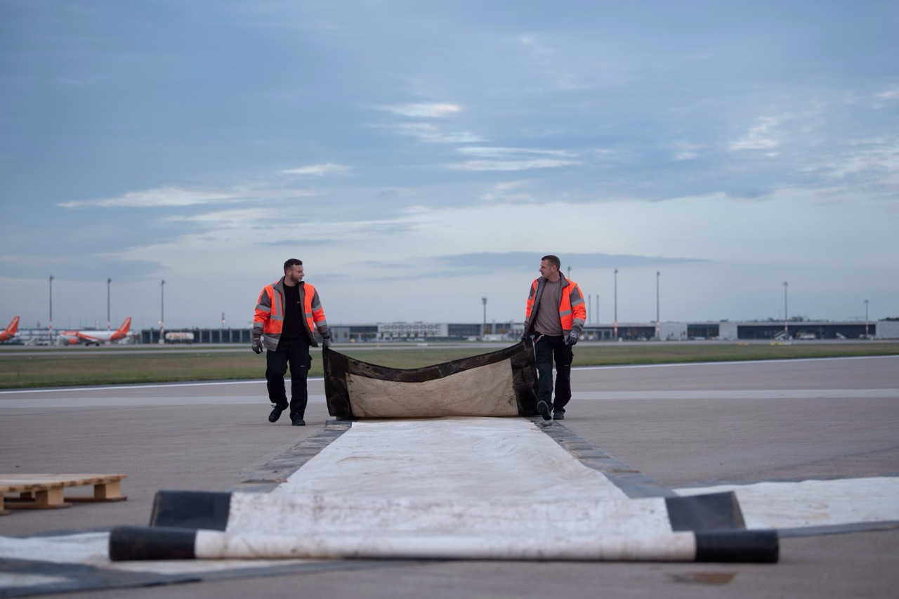 Make way for Qatar Airways and its first aircraft to land on the southern runway - the barrier crosses are already gone.